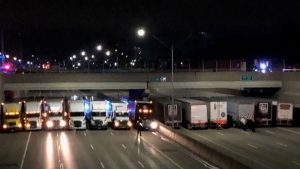 Truckers park under bridge to prevent suicide attempt